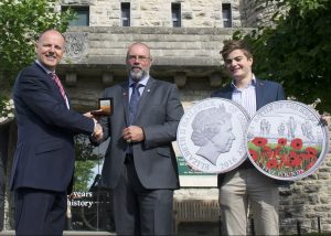 Stephen Allen presents the 'Battle of the Somme Centenary Proof £5 Coin' to Ian Jarvis, Community Fundraiser for The Royal British Legion. (L-R: Stephen Allen, Chairman, The Westminster Collection; Ian Jarvis, Community Fundraiser for The Royal British Legion Dorset; Max Allen, Stephen's eldest son.)