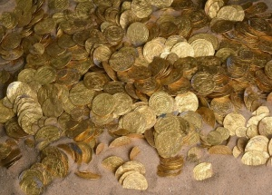 Nearly 2,000 gold coins were discovered off the coast of the ancient city of Caesarea, Israel. The gold coins are about 1,000 years old, and were minted by the Fatimid Caliphate, which ruled much of North Africa at the time. Credit: Israel Antiquities Authority