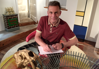 Chris Packham signing the limited edition Songbird Stamps Collector Card