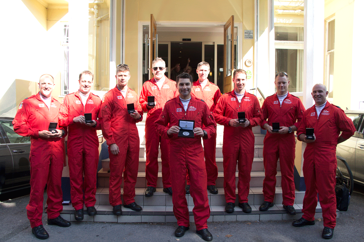 red arrows presented with medals at bournemouth air festival - All 9 Red Arrow pilots put their names to the ultimate Silver tribute...and we've just presented it to them!